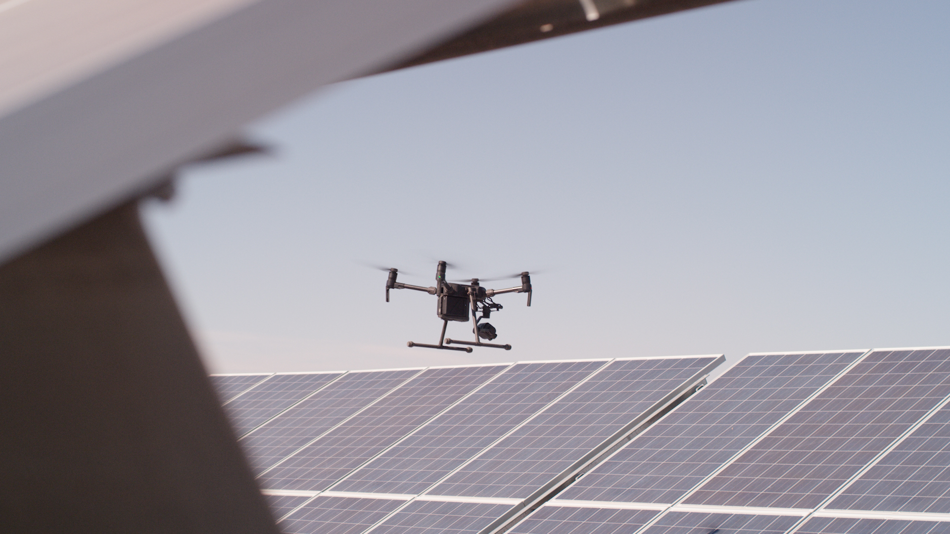 Drone above a photovoltaic system